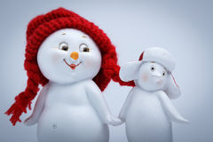 Cheerful snowman and penguin Royalty Free Stock Images