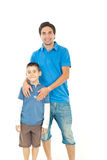 Cheerful son with his father. Standing together isolated on white background stock photos