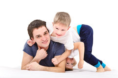Cheerful sons and father Stock Photos