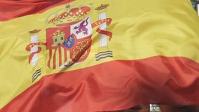 Cheerful Spanish friends actively jumping supporting national team, slow-mo stock video