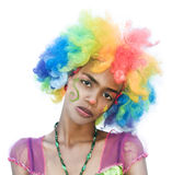 Cheerful Spoiled Female Clown. Cheerful Female Clown with a Spoiled Girl Expression Stock Photo