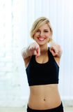 Cheerful sport woman pointing at you Royalty Free Stock Photo