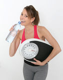 Cheerful sportive woman drinking water Royalty Free Stock Images