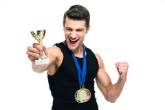 Cheerful sports man holding winner cup Stock Photography