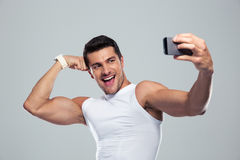 Cheerful sports man making selfie photo on smartphone Stock Photos