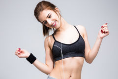 Cheerful sports woman with headphones Stock Images