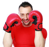 Cheerful sportsman in boxing gloves Royalty Free Stock Photo