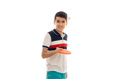 Cheerful sportsman practicing a table tennis with racket in hands and smiling on camera isolated on white background Stock Images