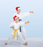 Cheerful sportsmen are training beat punch arm Stock Photos