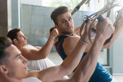 Cheerful sportsmen training in gym Royalty Free Stock Photo