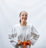 A cheerful sportswoman in karategi. Cheerful adult sportswoman in karategi Stock Photography