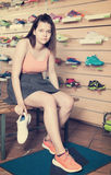Cheerful  sportswoman trying professional shoes Stock Images