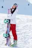 Cheerful sportswoman at winter mountain Royalty Free Stock Image