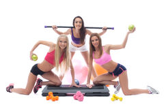 Cheerful sportswomen with gymnastic equipment Royalty Free Stock Photos