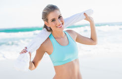 Cheerful sporty blonde in sportswear holding towel Royalty Free Stock Photo