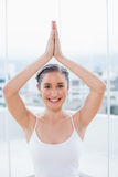 Cheerful sporty brunette sitting in yoga posture Royalty Free Stock Photography