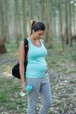 Sporty expectant mother on outdoor fitness workout stock images