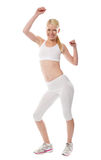 Cheerful sporty fit girl in sporty outfit Royalty Free Stock Photography