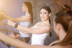 Cheerful sporty girls are using trx equipment Royalty Free Stock Photo