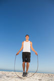 Cheerful sporty man jumping rope Stock Photography