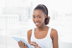 Cheerful sporty model holding tablet pc Royalty Free Stock Images