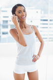 Cheerful sporty model on the phone Stock Photo