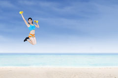 Cheerful sporty woman holding dumbbells Royalty Free Stock Photo