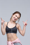 Cheerful sporty woman listening the music Stock Image
