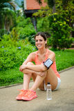 Cheerful sporty woman taking a workout rest Royalty Free Stock Image