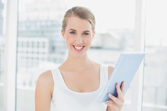 Cheerful sporty woman using tablet pc Stock Photos