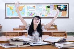 Cheerful student with books in class Stock Images