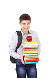 Cheerful Student with a Books. Happy Student with Knapsack Holding the Books Isolated on the White Background Royalty Free Stock Images