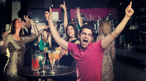 Cheerful student is dancing on party. In the bar Royalty Free Stock Images
