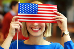 Cheerful student with flag of USA Royalty Free Stock Images