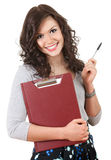Cheerful student girl with clipboard and pen Stock Photography