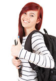 Cheerful student girl with rucksack and thumb up Stock Photos