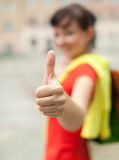 Cheerful student girl with thumb up, outside Royalty Free Stock Photos