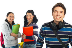 Cheerful student guy and his colleagues Stock Image