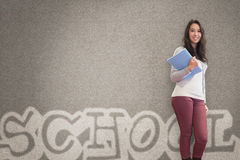Cheerful student holding notebook posing Stock Photos
