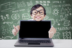 Cheerful student with laptop shows hand gesture Stock Photo