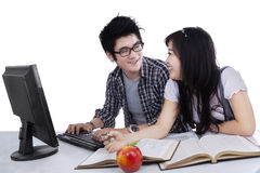 Cheerful student laughing together Stock Images