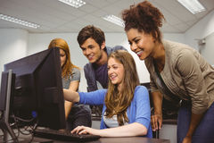 Cheerful student pointing at computer Royalty Free Stock Photo