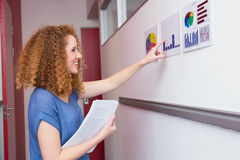 Cheerful student pointing the graphic Royalty Free Stock Photography