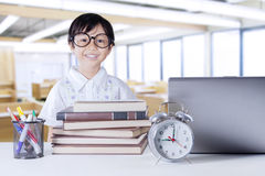 Cheerful student with science books in class Stock Photography