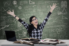 Cheerful student studying in class Royalty Free Stock Image