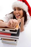Cheerful student wearing christmas hat royalty free stock photo