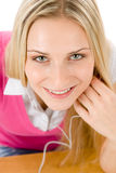 Cheerful student woman listen to music Stock Photo