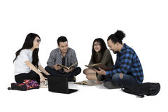 Cheerful students discussing on the floor Stock Photography