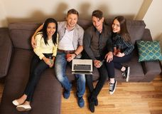 Cheerful students with laptop Stock Photography