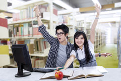 Cheerful students at library Stock Photo